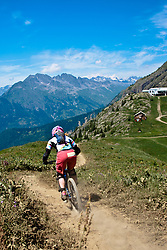 Cycling on a Single track Trail in the Mountains, Alpe d'Huez, France