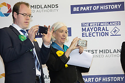 © Licensed to London News Pictures. 5/5/2017. Birmingham, UK. Birmingham Mayor Election results held at the Barclaycardarena, Birmingham. Pictured, candidates JAMES BURN (Green party), BEVERLEY NEILSEN (Lib Dems) taking pictures on the podium. Photo credit : Dave Warren/LNP