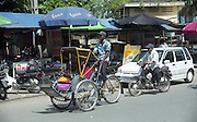 Cyclo taxis in Phnom Penh, Cambodia.