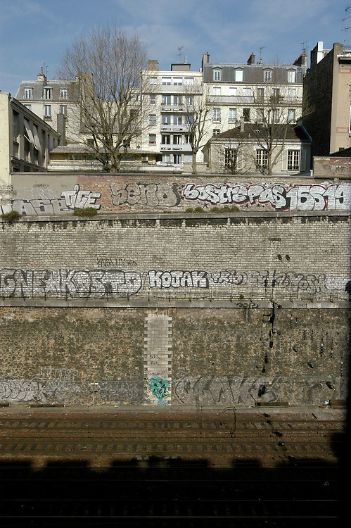 Graffiti along the railway lines leading to the Gare St. Lazare in the Batignolles neighborhood of Paris..Paris, France. 06/04/2009.Photo © J.B. Russell