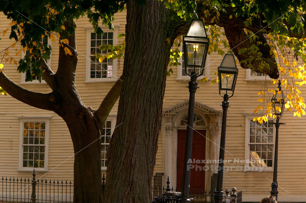 USA, Newport, RI - Old gas lamps and colonial home with fall color in Washington Squae and Touro St.