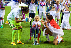 CARDIFF, WALES - Thursday, June 1, 2017: Olympique Lyonnais' goalkeeper Sarah Bouhaddi and Saki Kumagai celebrates with a child in the trophy after winning the UEFA Champions League following a penalty-shoot out victory during the UEFA Women's Champions League Final between Olympique Lyonnais and Paris Saint-Germain FC at the Cardiff City Stadium. (Pic by David Rawcliffe/Propaganda)