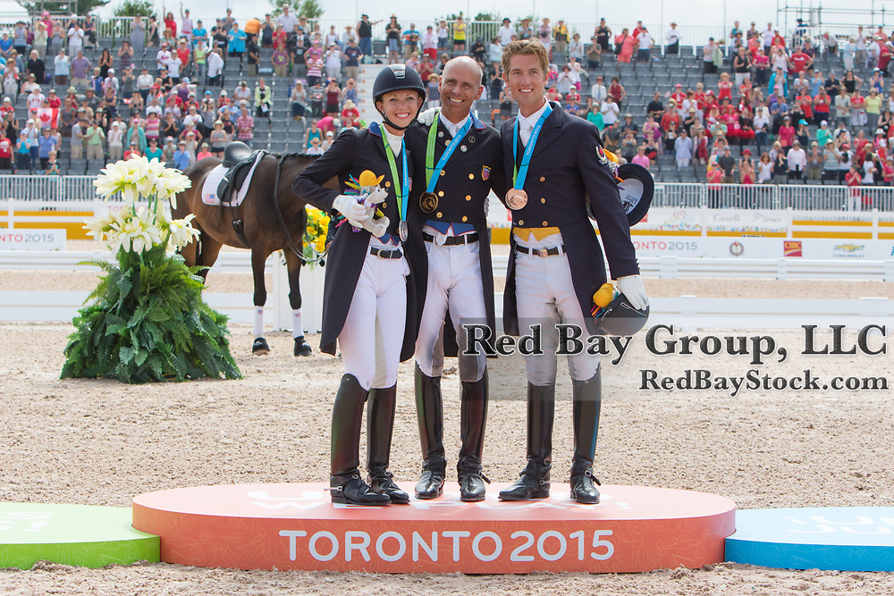 Steffen Peters, Laura Graves and Christopher von Martels on the podium at the OLG Caledon Pan Am Equestrian Park during the Toronto 2015 Pan American Games in Caledon, Ontario, Canada.