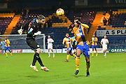 Mansfield Town forward Matt Green (10) goes round Crawley Town goalkeeper Glenn Morris (12) to set up a goal 3-0 during the EFL Sky Bet League 2 match between Mansfield Town and Crawley Town at the One Call Stadium, Mansfield, England on 19 November 2016. Photo by Simon Trafford.