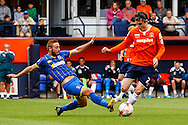 Matt Robinson of Luton Town (right) is tacked by Sammy Moore of AFC Wimbledon (left) during the Sky Bet League 2 match at Kenilworth Road, Luton<br /> Picture by David Horn/Focus Images Ltd +44 7545 970036<br /> 16/08/2014