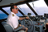 Captain steering ferry boat from bridge, enroute to Catalina Island, San Pedro Channel, southern California coast