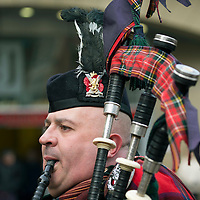 Remembrance Day Wreath Laying Ceremony at the Mercat Cross in Perth...11.11.13<br /> Private David Robertson from 7 Scots Royal Regiment of Scotland plays the pipes as the service draws to a comclusion<br /> Picture by Graeme Hart.<br /> Copyright Perthshire Picture Agency<br /> Tel: 01738 623350  Mobile: 07990 594431