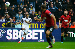 Swansea Midfielder Wayne Routledge (ENG) crosses the ball during the first half of the match - Photo mandatory by-line: Rogan Thomson/JMP - Tel: Mobile: 07966 386802 17/08/2013 - SPORT - FOOTBALL - Liberty Stadium, Swansea -  Swansea City V Manchester United - Barclays Premier League - First round of the 2013/14 season and the first league match for new Man Utd manager David Moyes.