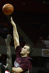12 February 2011: Will Creekmore extends for a shot over Tony Lewis during an NCAA Missouri Valley Conference basketball game between the Missouri State Bears and the Illinois State Redbirds at Redbird Arena in Normal Illinois.