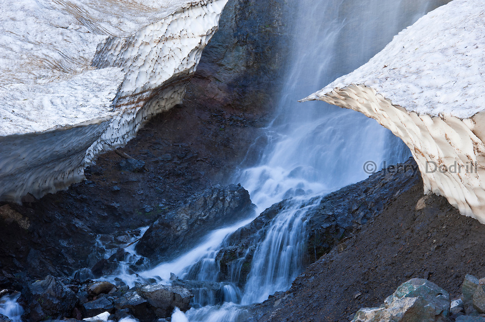 Snow bank melting below Sardine Falls, along the Pacific Crest Trail at Sonora Pass just off California Highway 108. At 9,624 feet, Sonora is the second highest pass in the Sierra Nevada Mountains.