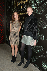 Left to right, IRIS VAN HERPEN and JADE PARFITT at a reception to celebrate Dom Perignon and Iris van Herpen's collaboration 'Metamorphosis' held at the Hus Gallery, 10 Hanover Street, London on 27th October 2014.