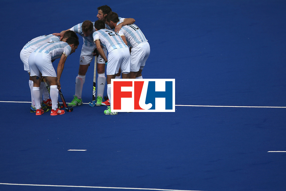 RIO DE JANEIRO, BRAZIL - AUGUST 11:  Team Argentina huddles against Germany during a Men's Preliminary Pool B match on Day 6 of the Rio 2016 Olympics at the Olympic Hockey Centre on August 11, 2016 in Rio de Janeiro, Brazil.  (Photo by Sean M. Haffey/Getty Images)