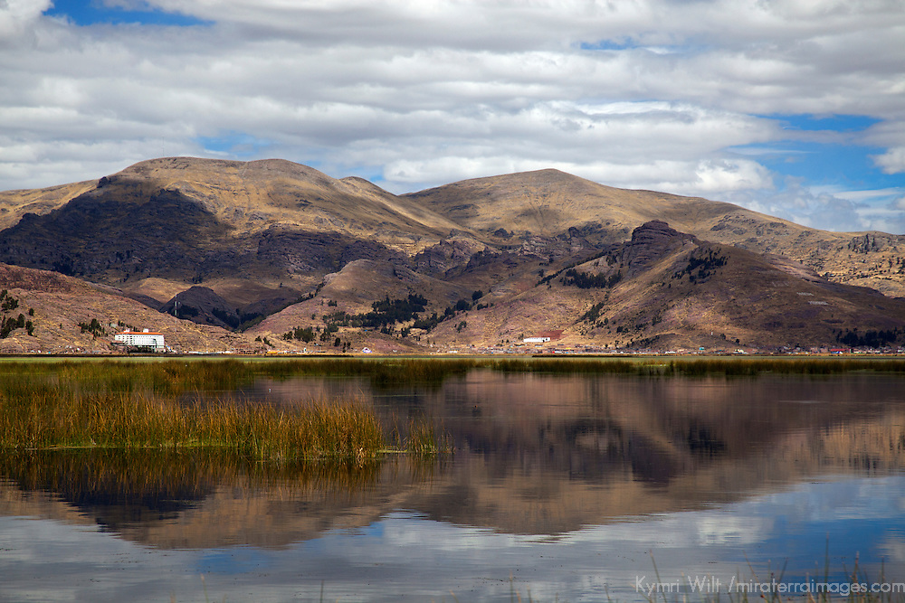 South America, Peru, Lake Titicaca. Reflecrtion of Lake Titicaca scenery near Puno.