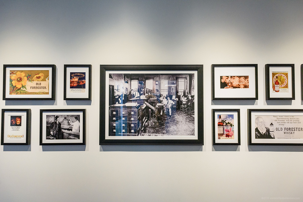 Historical photos of the first distlled spirit to be advertised are on display along the tour of the Old Forester Distilling Company on Whisky Row in Louisville, Ky. June 6, 2018