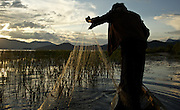 A fisherman at the legendary Lugu Hu Lake in Sichuan Province, southwestern China.