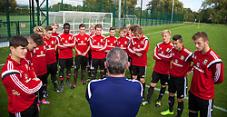 NEWPORT, WALES - Wednesday, September 24, 2014: Wales' head coach Osian Roberts with the players before a training session at Dragon Park ahead of the Under-16's International Friendly match against France. (Pic by David Rawcliffe/Propaganda)