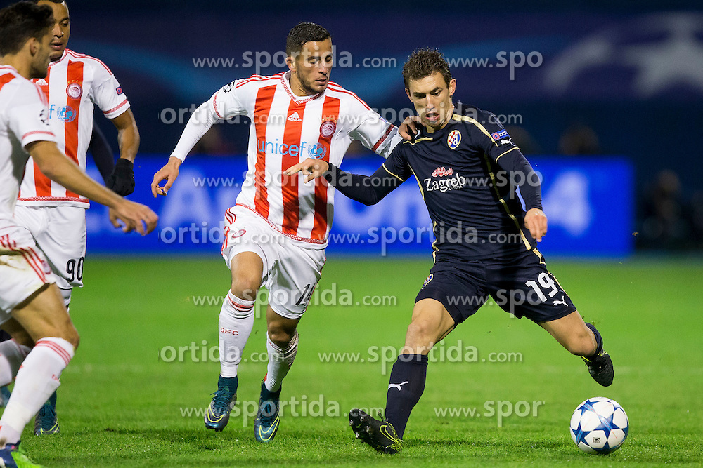 Omar Elabdellaoui #14 of Olympiakos and Josip Pivaric #19 of GNK Dinamo Zagreb during football match between GNK Dinamo Zagreb and Olympiakos in Group F of Group Stage of UEFA Champions League 2015/16, on October 20, 2015 in Stadium Maksimir, Zagreb, Croatia. Photo by Urban Urbanc / Sportida