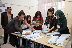 © Licensed to London News Pictures. 30/04/2014. Sulaimaniya, Iraq. Officials count ballot papers in a school used as a polling station after voting closes for the 2014 Iraqi parliamentary elections in Sulaimaniya, Iraqi-Kurdistan today (30/04/2014). <br /> <br /> The period leading up to the elections, the fourth held since the 2003 coalition forces invasion, has already seen polling stations in central Iraq hit by suicide bombers causing at least 27 deaths. Photo credit: Matt Cetti-Roberts/LNP