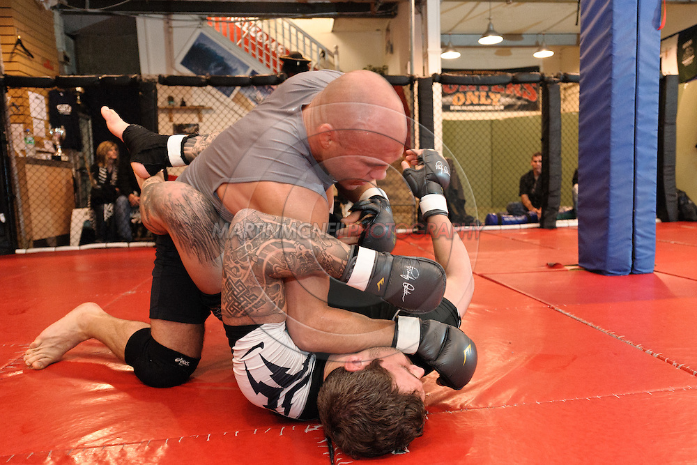Randy Couture (top) and Neil Melanson work on ground techniques during a pre-fight training session at Straight Blast Gym ahead of UFC 105 in Manchester, England on November 12, 2009.