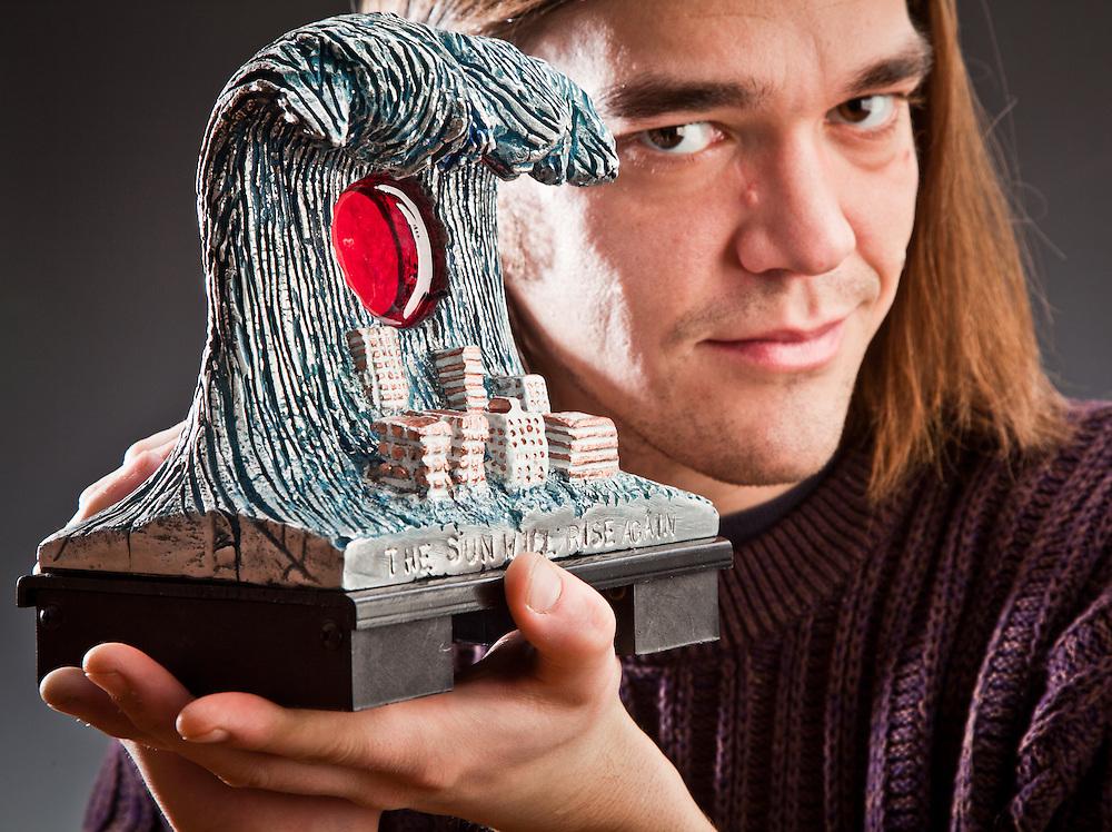 UAA Art student, Scott Pugh, and his sculpture, Tsunami Sunrise, Anchorage