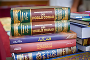 "Sept. 10 - GLENDALE, AZ: Spanish language Qurans (also called Korans) available in the Glendale Civic Center before Eid ul-Fitr services. Muslims from the Phoenix area celebrated Eid ul-Fitr, the end of Ramadan, at the Glendale Civic Center in Glendale, AZ, a suburb of Phoenix. Eid ul-Fitr, often abbreviated to Eid, is the Muslim holiday that marks the end of Ramadan, the Islamic holy month of fasting. Eid is an Arabic word meaning ""festivity"", while Fitr means ""conclusion of the fast""; and so the holiday symbolizes the celebration of the conclusion of the month of fasting from dawn to sunset during the entire month of Ramadan. The first day of Eid, therefore, is the first day of the month Shawwal that comes after Ramadan.  Photo by Jack Kurtz"