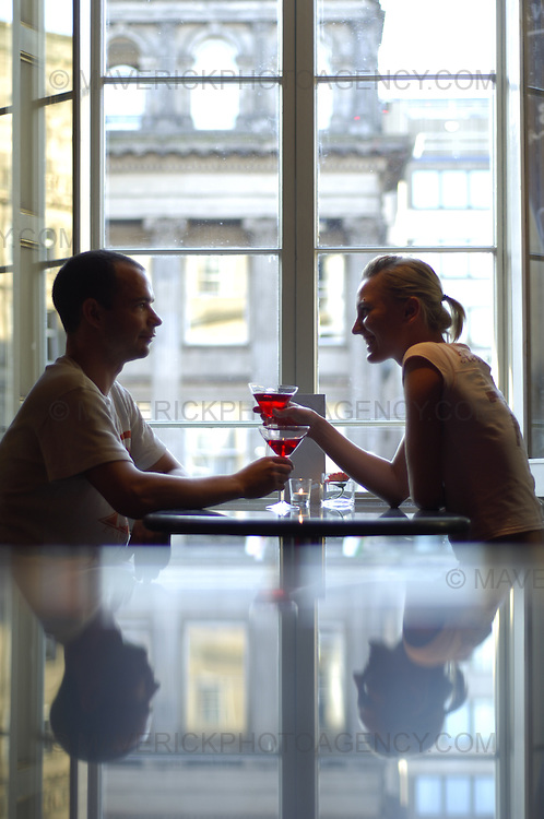 A couple enjoys a cocktail at Le Monde Bar Restaurant on George Street in Edinburgh.  Pictured Alan Tate and Magda Janowska enjoying the atmosphere.