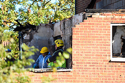 © Licensed to London News Pictures. 22/10/2018. LONDON, UK.  Memberd of the Fire Investigations Team at work at the site of a fire in a first-floor flat, caused by a suspected gas explosion, in Fulbeck Way, Harrow, north west London, which took place in the early hours of 21 October.  It has been reported that a woman died at the scene, and another woman, a man and a baby were rescued from the property. Investigations continue as to the cause of the fire. Photo credit: Stephen Chung/LNP