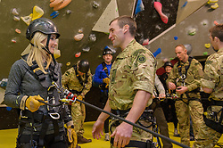 Royal Marines abseil down BT Tower. the BT Tower, London, United Kingdom. Embargoed until Monday, 17th February 2014. Picture by Anthony Upton / i-Images<br /> <br /> TV presenter Helen Skelton with Sgt. Simon Wright-Hider RM during the training at the Castle Climbing centre, in north London ahead of the first ever charity abseil down BT Tower will take place on 10 March to raise money for Sport Relief and the Royal Marines Charitable Trust Fund using BT&rsquo;s MyDonate online fundraising site.<br /> <br /> The event will also kick off a year of celebrations for the 350th anniversary of the Royal Marines, during which the Royal Marines Charity Trust Fund (RMCTF) aim to raise &pound;6million