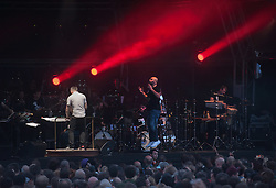 © Licensed to London News Pictures. 25/07/2015. Bristol, UK.  GOLDIE in concert at the Lloyds Amphitheatre in Bristol Docks, with the Heritage Orchestra conducted by Charles Hazlewood and with vocals by Vanessa Haynes.  Photo credit : Simon Chapman/LNP
