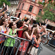 May 26, 2012 - New York, NY : Waiting on West 75th Street, fans of pop sensation 'One Direction' scream and wave as they  spot band members through windows of the Beacon theater in Manhattan on  Saturday afternoon. The group is on the road for their first-ever headlining North American tour in support of their debut album UP ALL NIGHT. CREDIT: Karsten Moran for The New York Times