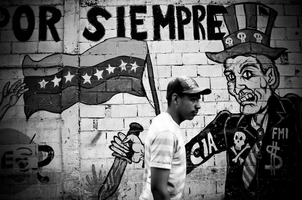 A man passes an anti-American mural in El Junquito, a slum on the outskirts of Caracas.