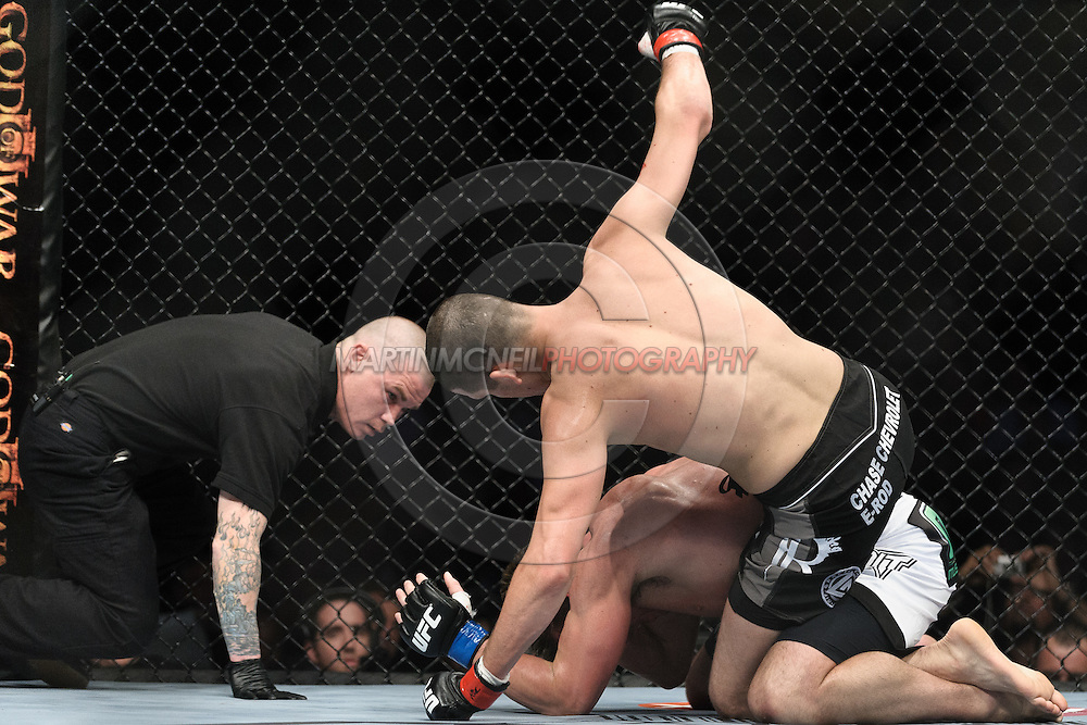 """NEWARK, NEW JERSEY, MARCH 27, 2010: Nate Diaz (top) and Rory Markham are pictured during their bout at """"UFC 111: St. Pierre vs. Hardy"""" in the Prudential Center, New Jersey on March 27, 2010"""