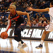 Elashier Hall, Syracuse, dribbles past Bria Hartley, Connecticut, during the Connecticut V Syracuse Semi Final match during the Big East Conference, 2013 Women's Basketball Championships at the XL Center, Hartford, Connecticut, USA. 11th March. Photo Tim Clayton