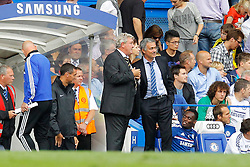 Hull City's Manager Steve Bruce and Chelsea's manager Jose Mourinho watch the match together  - Photo mandatory by-line: Mitchell Gunn/JMP - Tel: Mobile: 07966 386802 18/08/2013 - SPORT - FOOTBALL - Stamford Bridge - London -  Chelsea v Hull City - Barclays Premier League