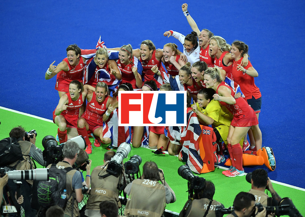 Britain's players celebrate their victory at the end of the women's Gold medal hockey Netherlands vs Britain match of the Rio 2016 Olympics Games at the Olympic Hockey Centre in Rio de Janeiro on August 19, 2016. / AFP / Pascal GUYOT        (Photo credit should read PASCAL GUYOT/AFP/Getty Images)