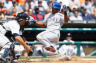 May 22, 2014; Detroit, MI, USA; Texas Rangers third baseman Adrian Beltre (29) slides in safe at home ahead of the tag by Detroit Tigers catcher Alex Avila (13) in the third inning at Comerica Park. Mandatory Credit: Rick Osentoski-USA TODAY Sports