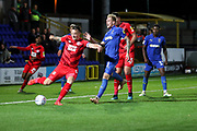 Leyton Orient defender Josh Coulson (6) clearing the ball from AFC Wimbledon midfielder Mitchell (Mitch) Pinnock (11) during the Leasing.com EFL Trophy match between AFC Wimbledon and Leyton Orient at the Cherry Red Records Stadium, Kingston, England on 8 October 2019.