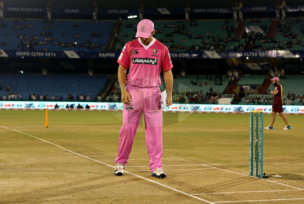 Daniel Flynn Captain of Northern Knights checks the pitch before the start of the  match 3 of the Oppo Champions League Twenty20 between the Cape Cobras and the Northern Knights held at the Chhattisgarh International Cricket Stadium, Raipur, India on the 19th September 2014<br /> <br /> Photo by:  Sandeep Shetty / Sportzpics/ CLT20<br /> <br /> <br /> Image use is subject to the terms and conditions as laid out by the BCCI/ CLT20.  The terms and conditions can be downloaded here:<br /> <br /> http://sportzpics.photoshelter.com/gallery/CLT20-Image-Terms-and-Conditions-2014/G0000IfNJn535VPU/C0000QhhKadWcjYs
