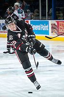 KELOWNA, CANADA -FEBRUARY 5: Cole Chorney C #15 of the Red Deer Rebels takes a shot during warm up against the Kelowna Rockets on February 5, 2014 at Prospera Place in Kelowna, British Columbia, Canada.   (Photo by Marissa Baecker/Getty Images)  *** Local Caption *** Cole Chorney;