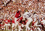 COLLEGE FOOTBALL: Stanford vs Michigan played on October 5, 1974 at Stanford Stadium in Palo Alto, California.  Stanford quarterback Jerry Waldvogel #15 attempts a pass.