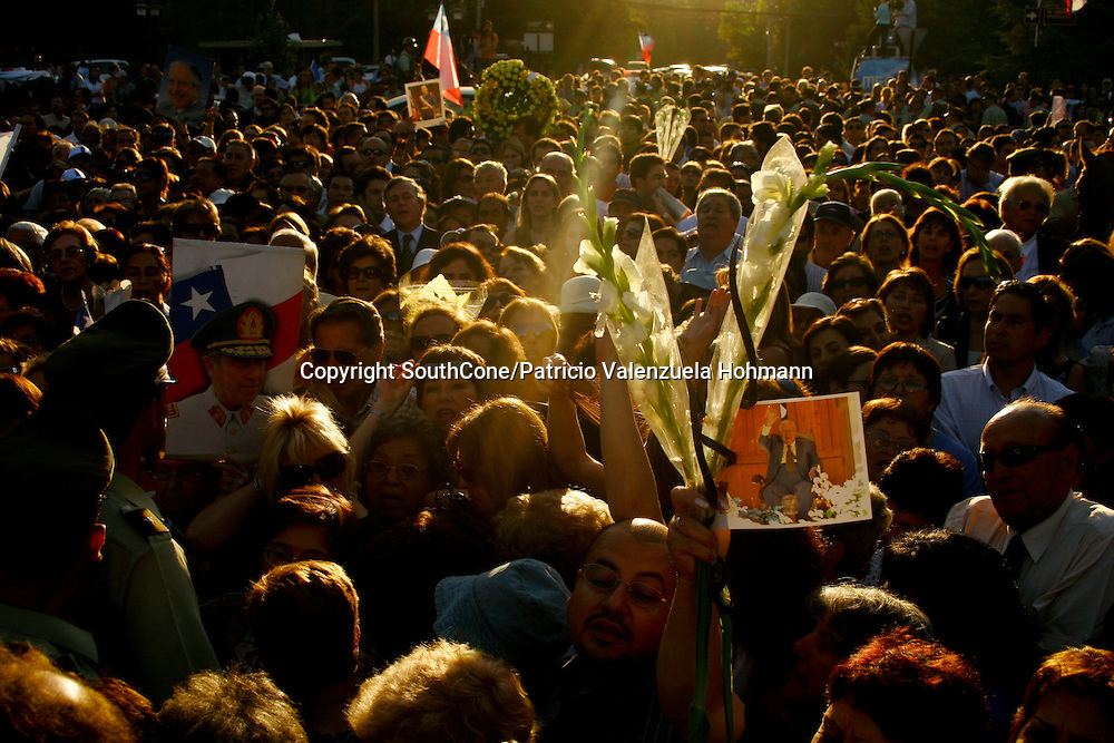 Thousands gather outside Santiago's Military School to farewell Pinochet.<br /> December 2006, The Chilean Dictator Augusto Pinochet died in Santiago Chile. As news spread thousands went out the streets either to celebrate o mourn Pinochet who lead the 1973 coup that overthrew the democratically elected president Salvador Allende. Pinochet's 17 year regime killed and disappeared around 4.000 people, tortured and exile around 20.000. On 1989 he lost elections and democracy was regained. He died on late December 2006. December 2006, The Chilean Dictator Augusto Pinochet died in Santiago Chile. As news spread thousands went out the streets either to celebrate o mourn Pinochet who lead the 1973 coup that overthrew the democratically elected president Salvador Allende. Pinochet's 17 year December 2006, The Chilean Dictator Augusto Pinochet died in Santiago Chile. As news spread thousands went out the streets either to celebrate o mourn Pinochet who lead the 1973 coup that overthrew the democratically elected president Salvador Allende. Pinochet's 17 year.