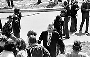 705/4-4 (7)...  Glenn Frank, geology professor and faculty peace marshall, urges students to leave the Prentice Hall parking lot after the shootings May 4, 1970.
