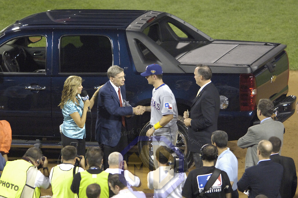 11 July 2006:  Baseball Commissioner Bud Selig presents the Most Valuable Player award to American League All-Star Michael Young of the Texas Rangers who hit the game winning triple in the 9th inning to seal the victory for the American League at the 77th All-Star game at PNC Park in Pittsburgh, Pa.   The American League All-Stars defeated the National League All-Stars 3-2.