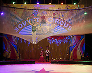 A performer waves to the crowd after her performance for the traveling Soviet Circus in Surabaya, Indonesia.