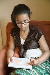 Teenage girl in her drawing,