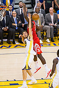 Golden State Warriors guard Klay Thompson (11) boxes out Houston Rockets center Clint Capela (15) during Game 6 of the Western Conference Finals at Oracle Arena in Oakland, Calif., on May 26, 2018. (Stan Olszewski/Special to S.F. Examiner)