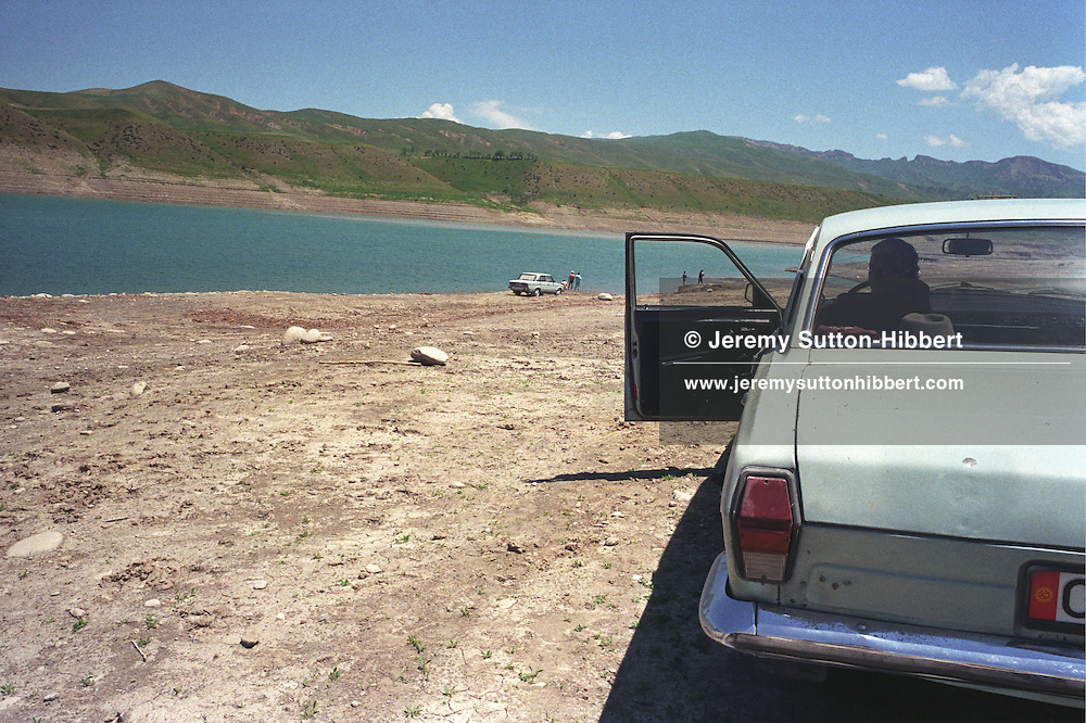 Visitors to the Papan reservoir, near the city of Osh, once one of the great cities of the Silk Road and of Central Asia, and the second biggest city in the country, situated in the unstable Ferghana valley which is now becoming a hotbed if Islamic Fundamentalism. Osh, Kyrgyzstan.
