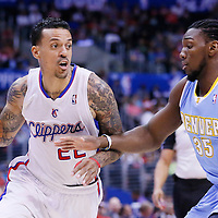 15 April 2014: Los Angeles Clippers forward Matt Barnes (22) drives past Denver Nuggets forward Kenneth Faried (35) during the Los Angeles Clippers 117-105 victory over the Denver Nuggets at the Staples Center, Los Angeles, California, USA.