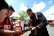 AFC Bournemouth forward Joshua King signing autographs for the fans as he arrives for the Premier League match between Bournemouth and Burnley at the Vitality Stadium, Bournemouth, England on 13 May 2017. Photo by Graham Hunt.