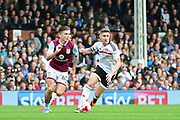 Aston Villa midfielder Jack Grealish (40) and Fulham midfielder Tom Cairney (10) in action during the EFL Sky Bet Championship match between Fulham and Aston Villa at Craven Cottage, London, England on 17 April 2017. Photo by Jon Bromley.